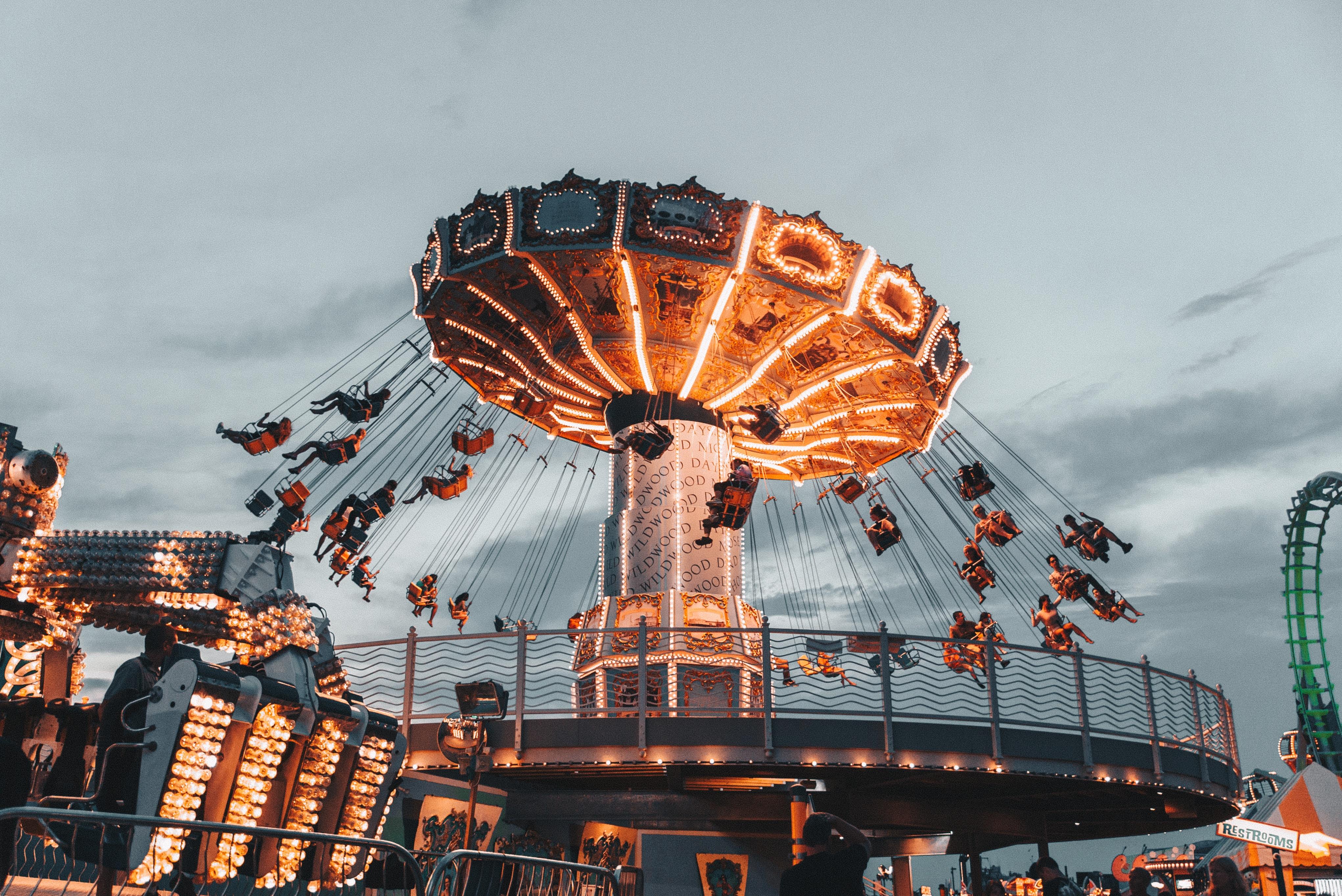 people riding amusement park ride