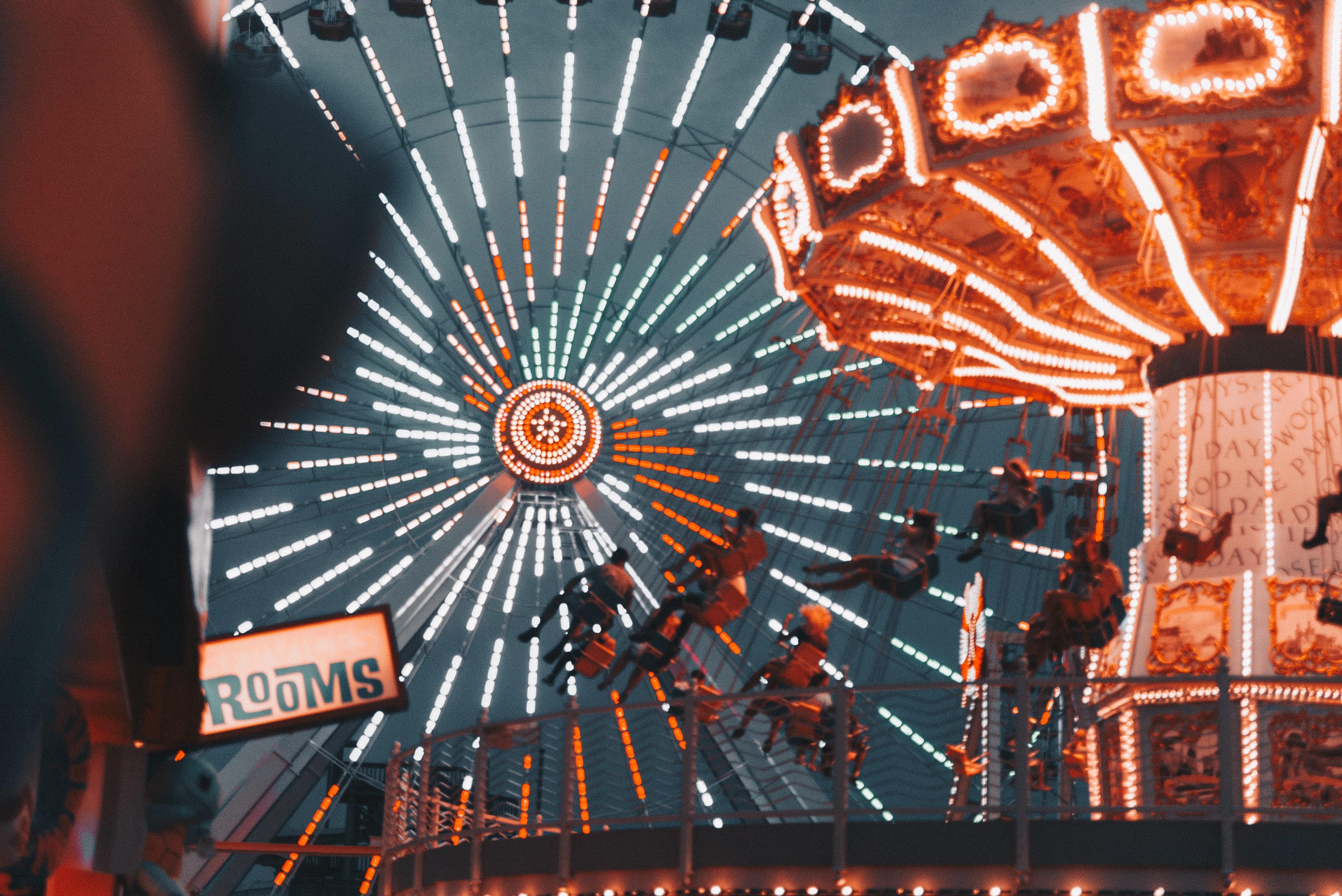 people riding on ferris wheel at night