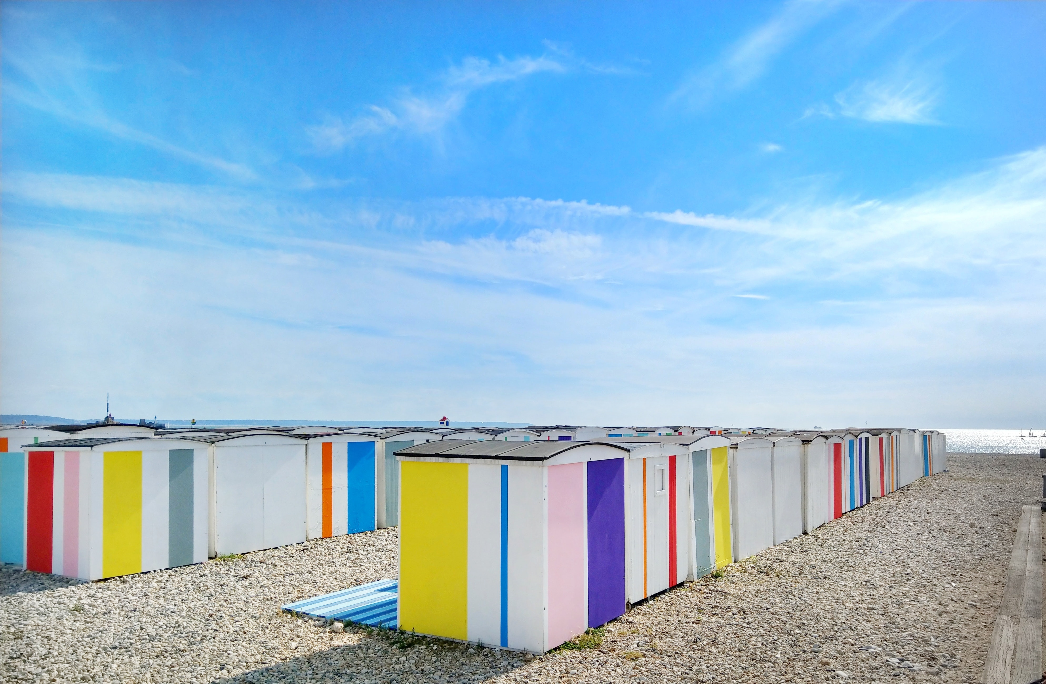 Colorful beach changing rooms at the pebble beach in Le Havre
