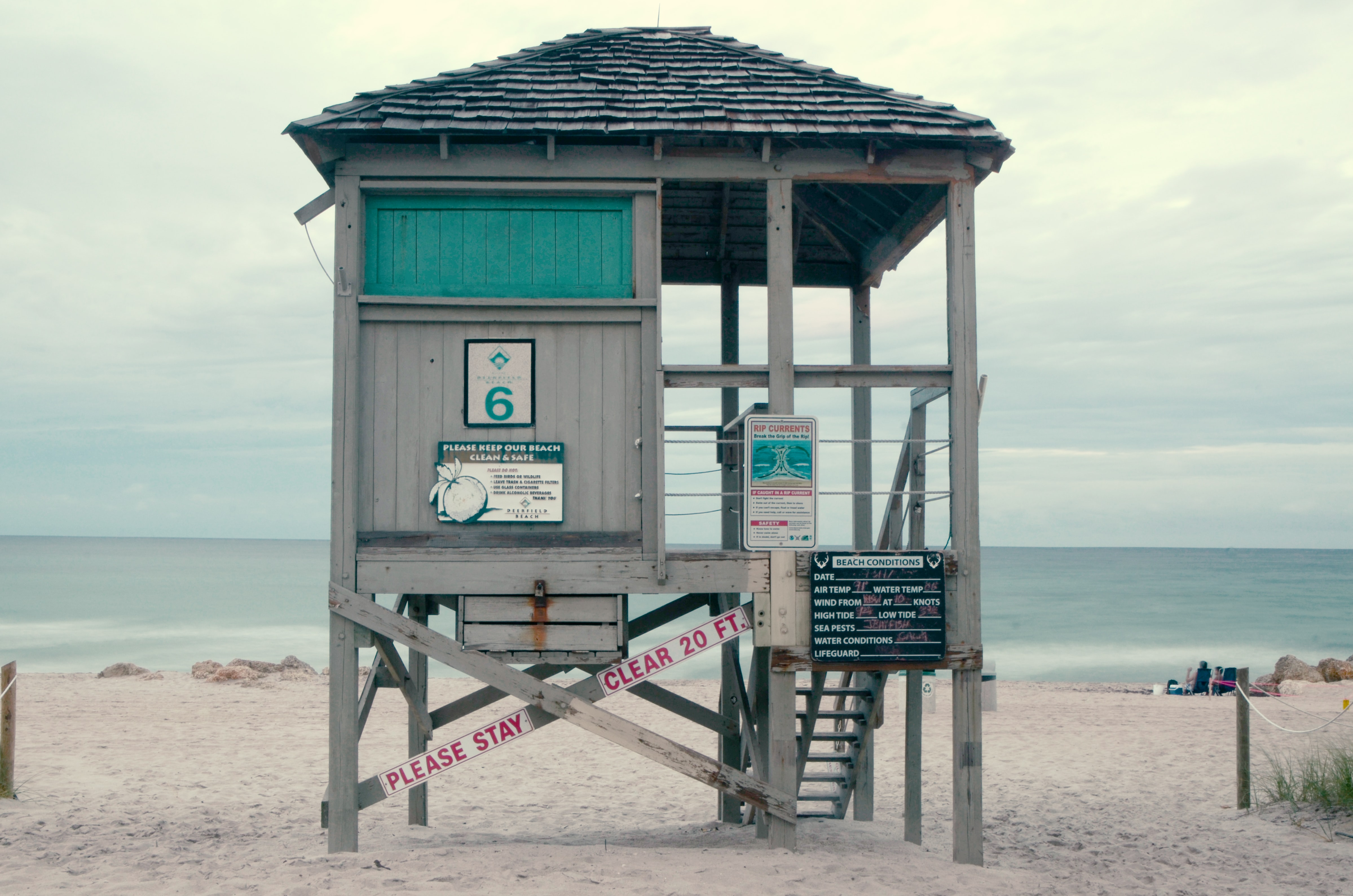 empty brown and green wooden lifeguard house