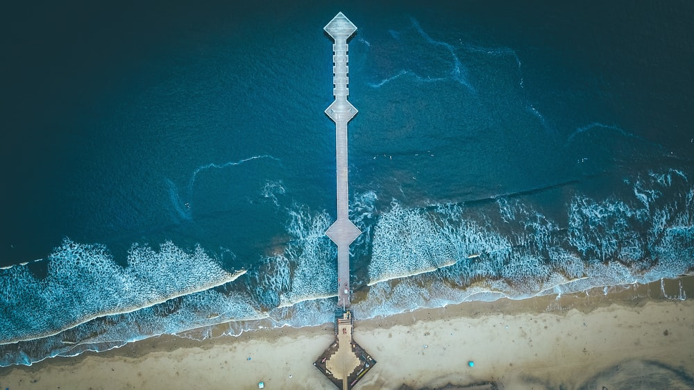 aerial photography of dock on sea