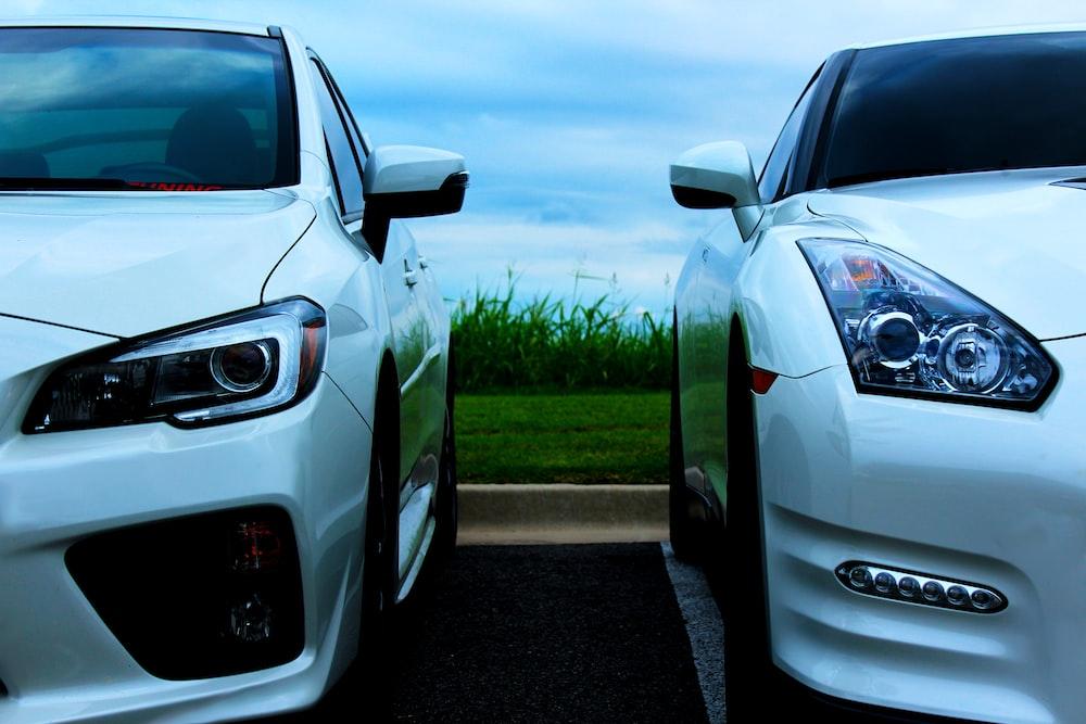 white Nissan GT-R and white Mitsubishi Lancer Evolution 10