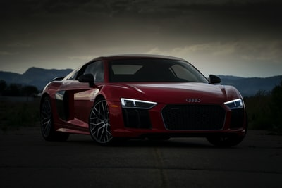 red audi coupe audi zoom background