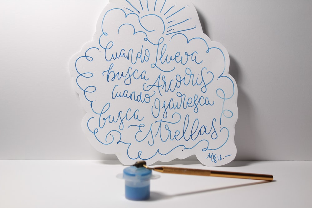 white and blue text wall decor