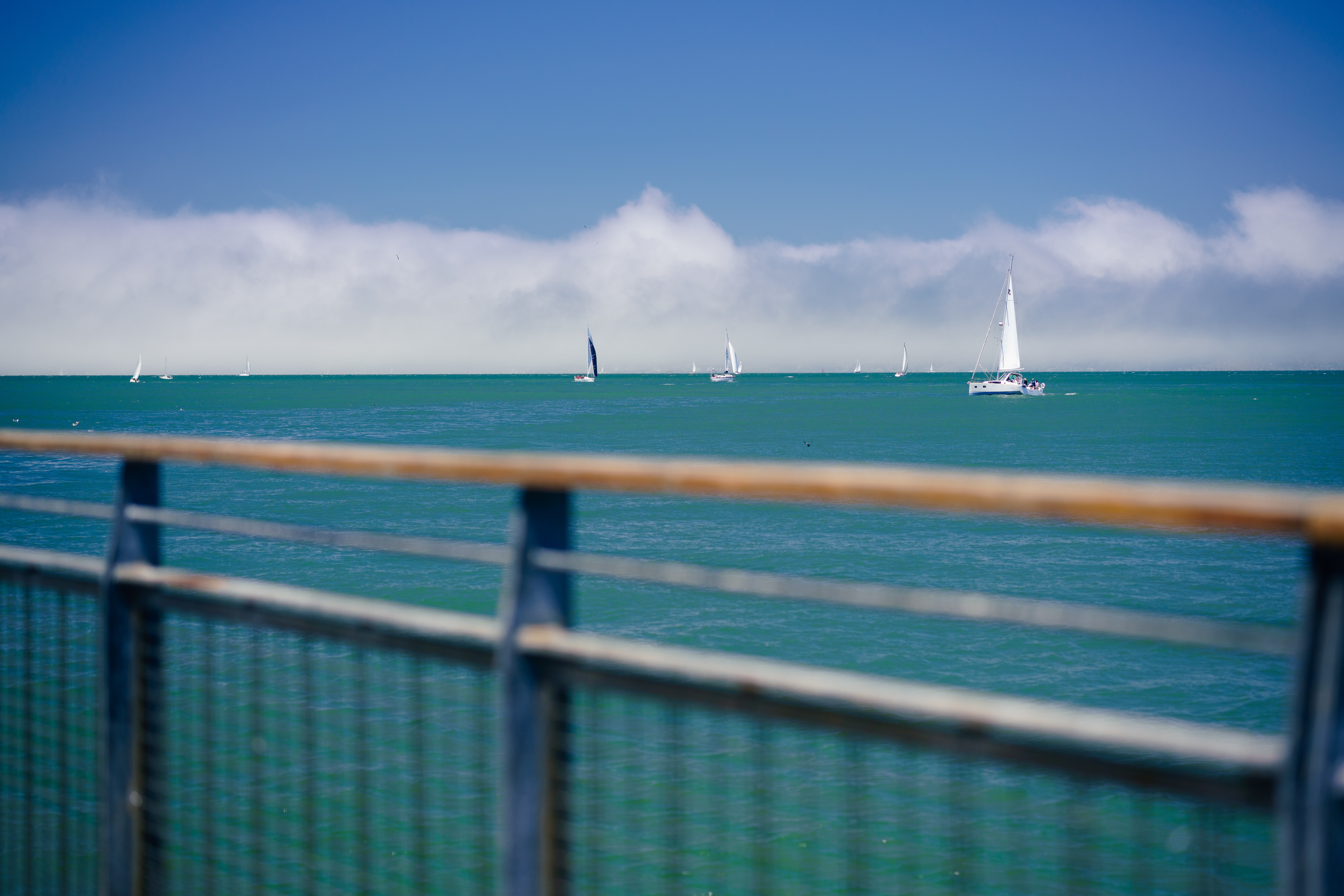 sailboats on seat under blue sky