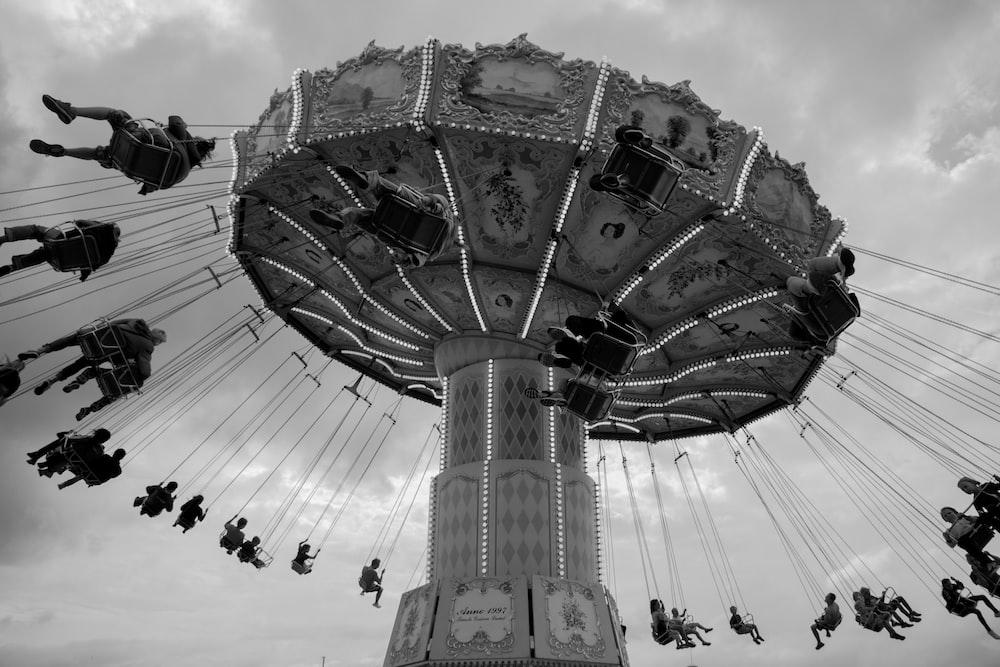 people on amusement park riding on ride