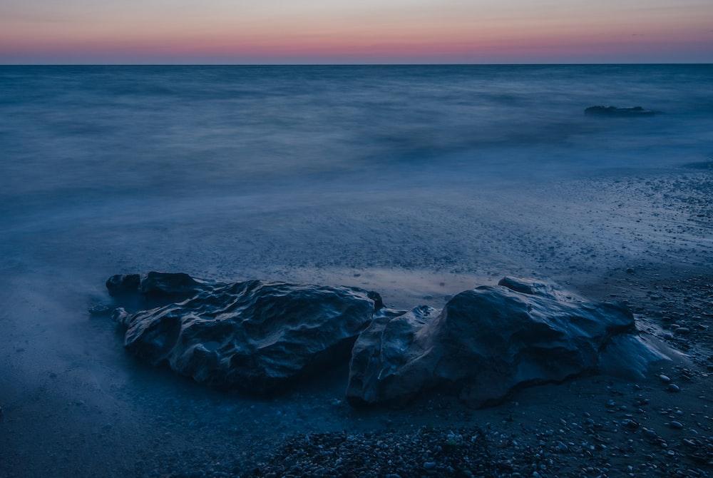 grey rock on sand