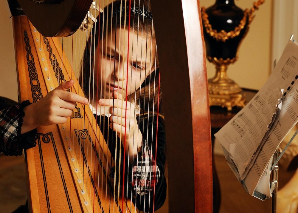 girl playing harp