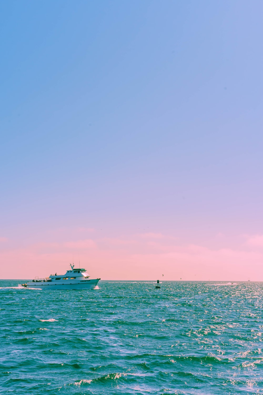 white yacht sailing during day