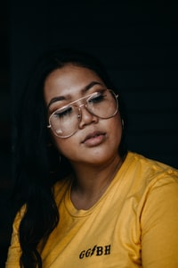 woman in yelow crew-neck T-shirt