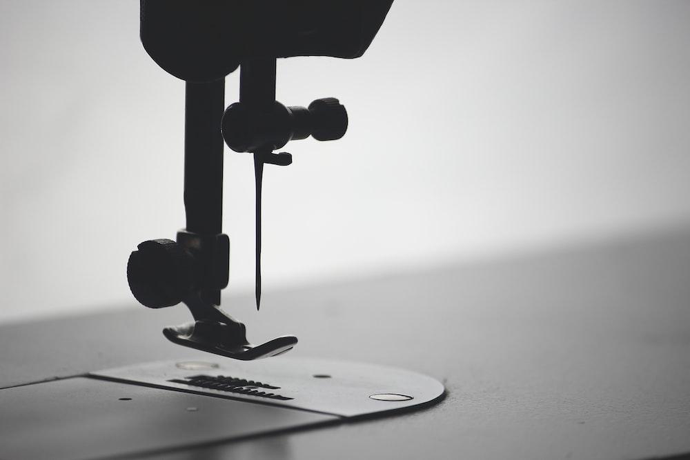 macro photography of sewing needle