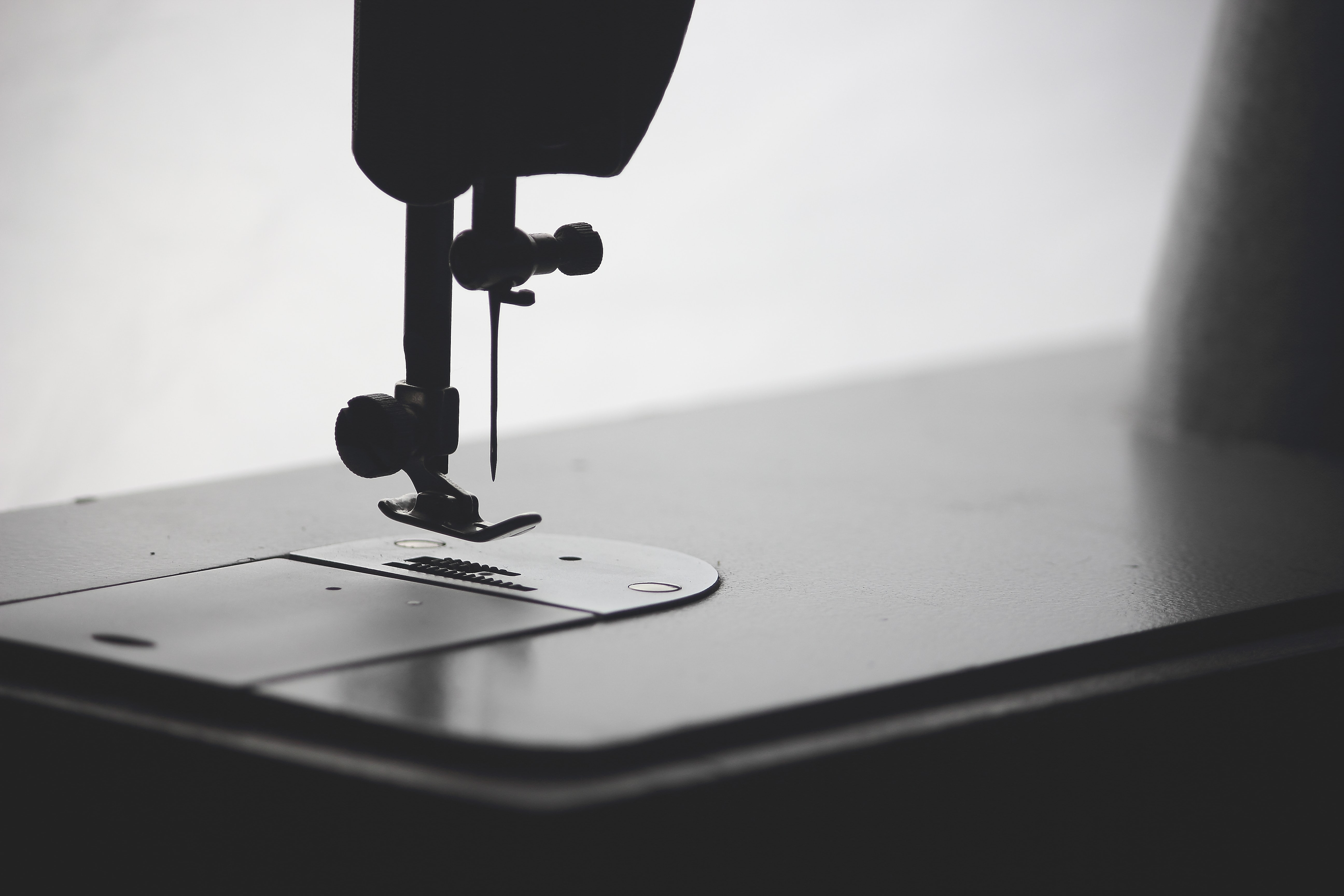 Silhouette of the needle and foot of a sewing machine