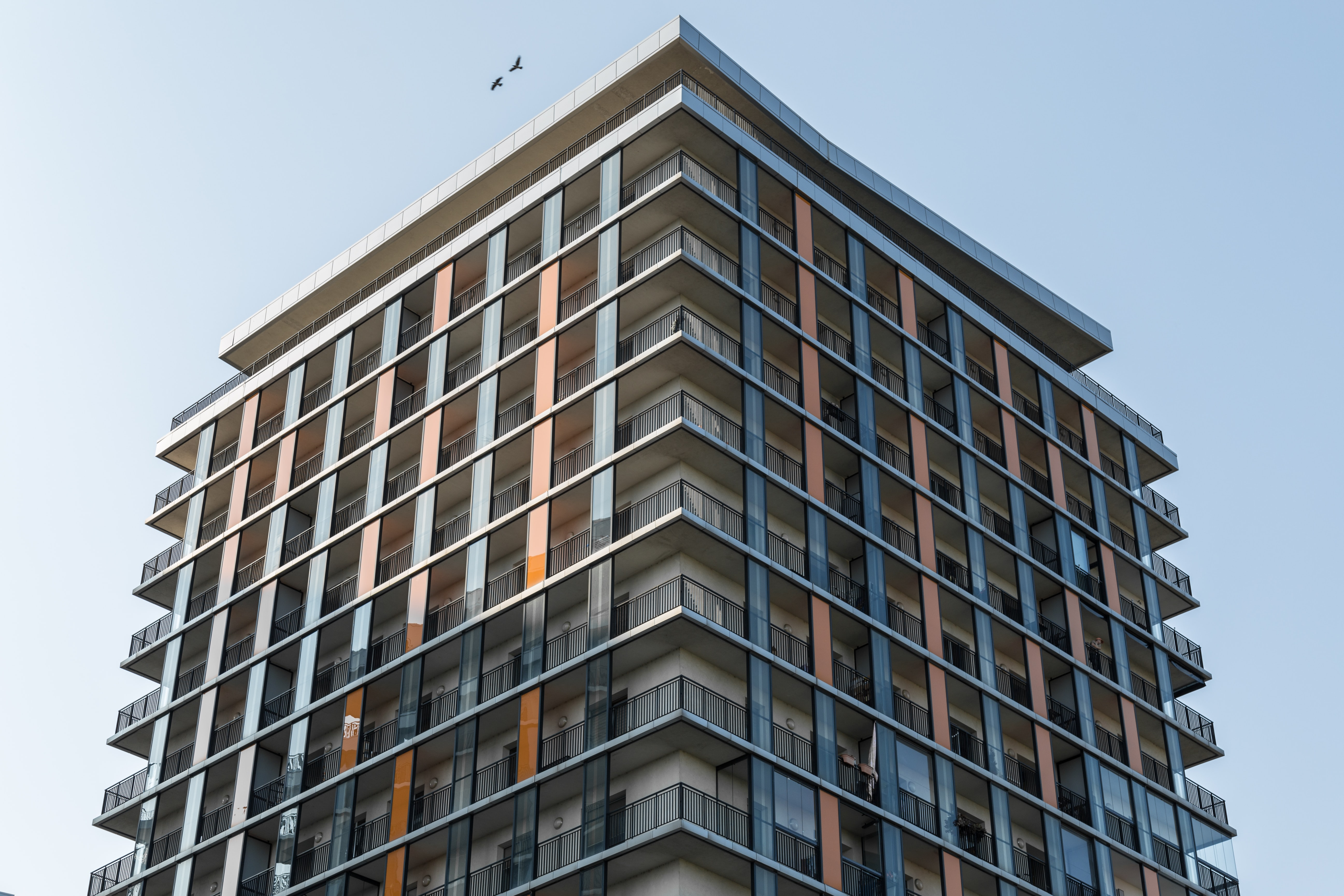 low angle photograph of beige and orange concrete building