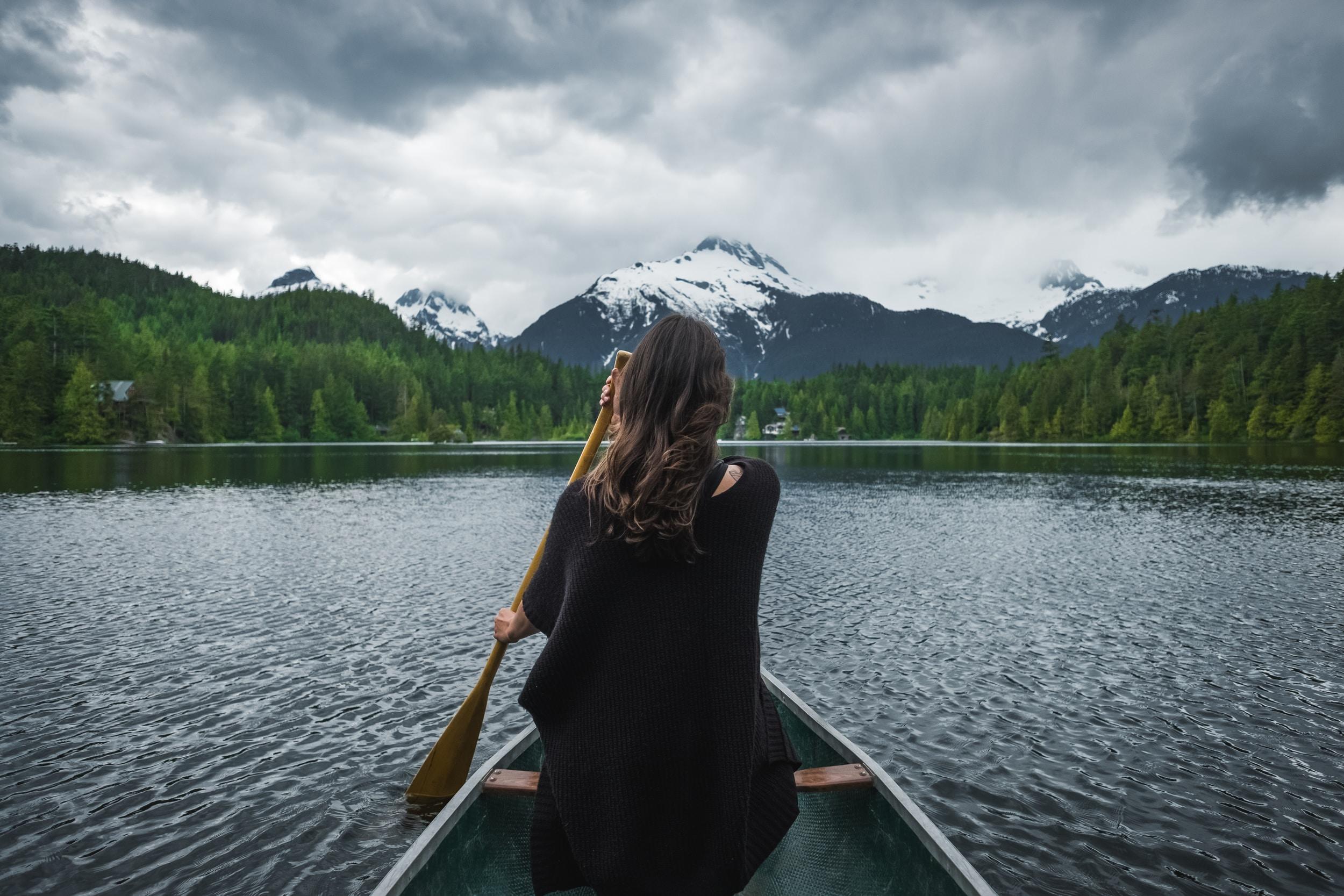 woman riding boat sailing