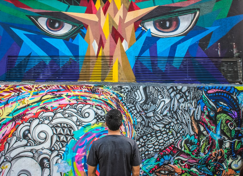 photography of man seeing doddle wall art