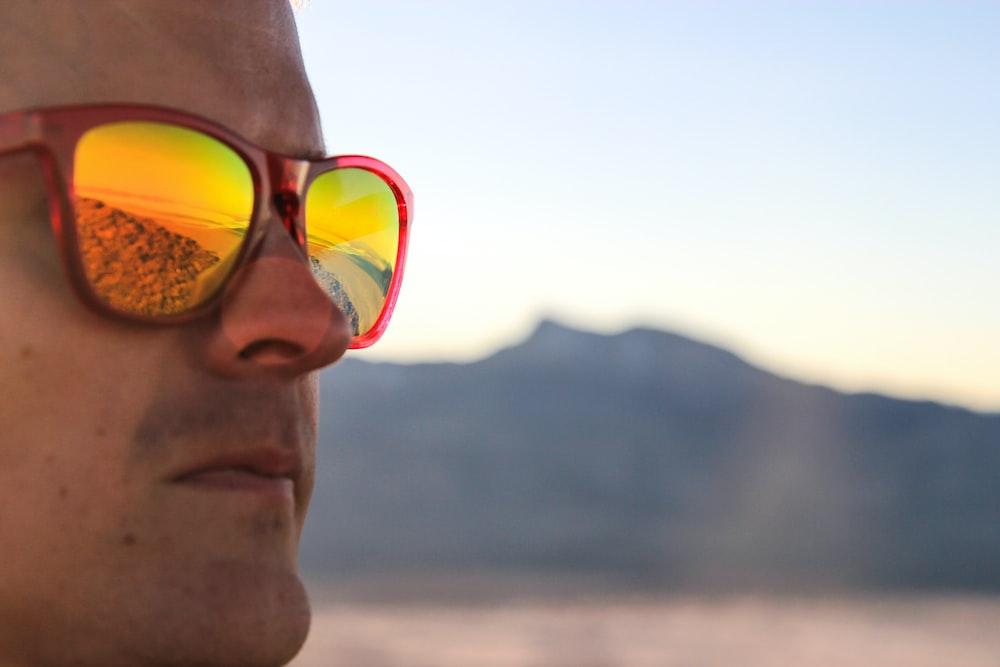 man wearing yellow framed sunglasses