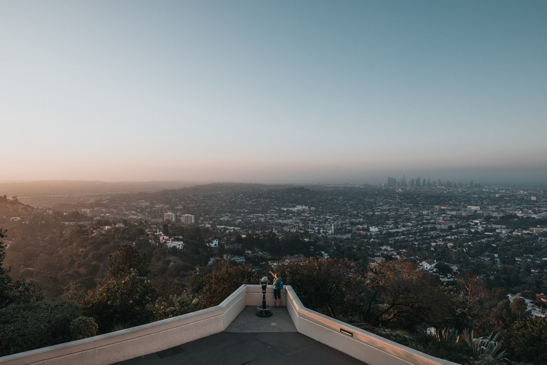 Many of my favorite memories come just before the sunrise.  I woke up at 4AM and drove an hour to the Griffith Observatory to catch a quiet sunrise.  However, when I arrived I was greeted by around 200 people who apparently had the same idea.