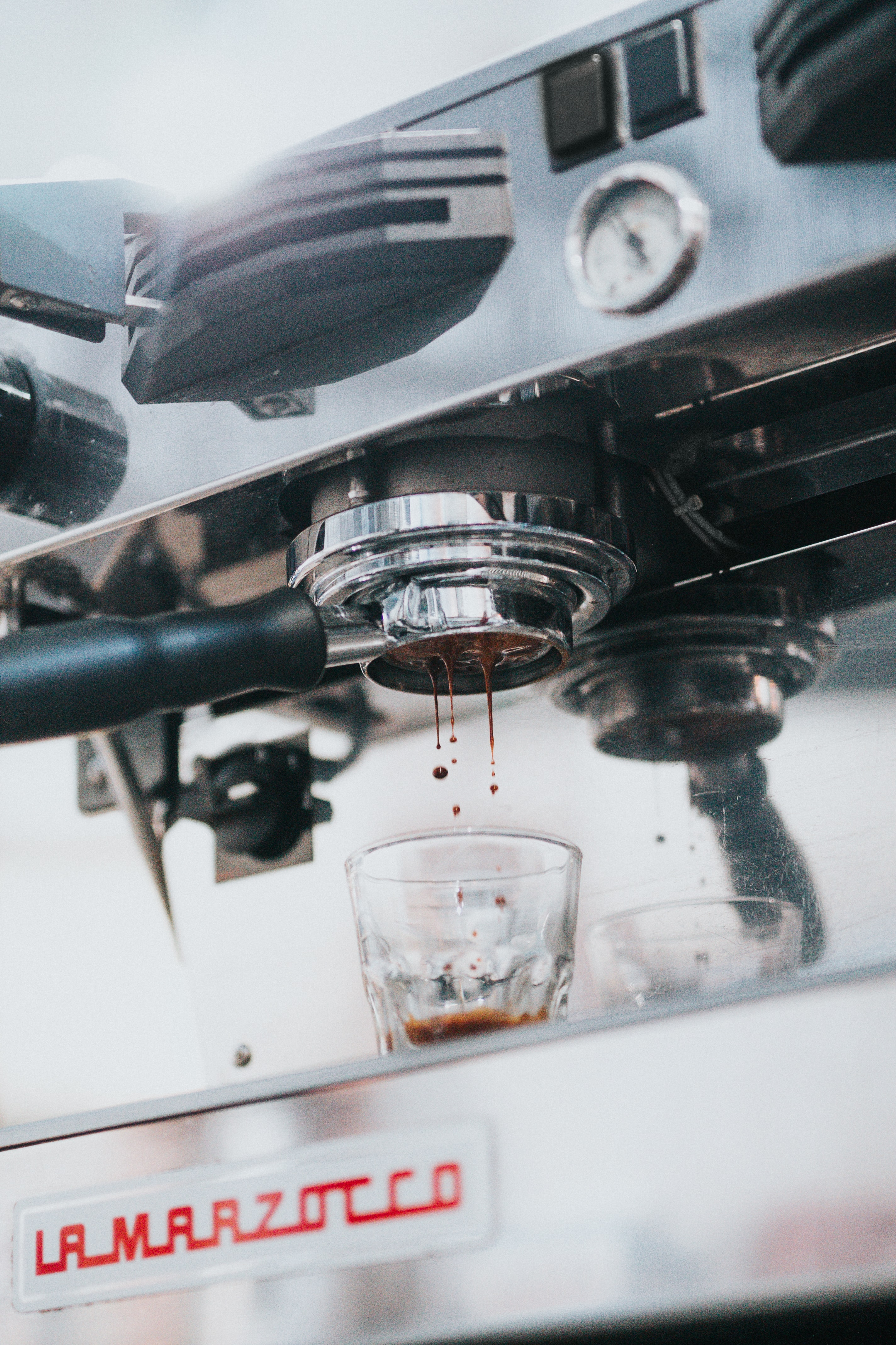 selective focus photo of espresso machine