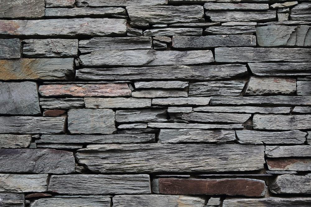 minimalist photography of gray rock wall
