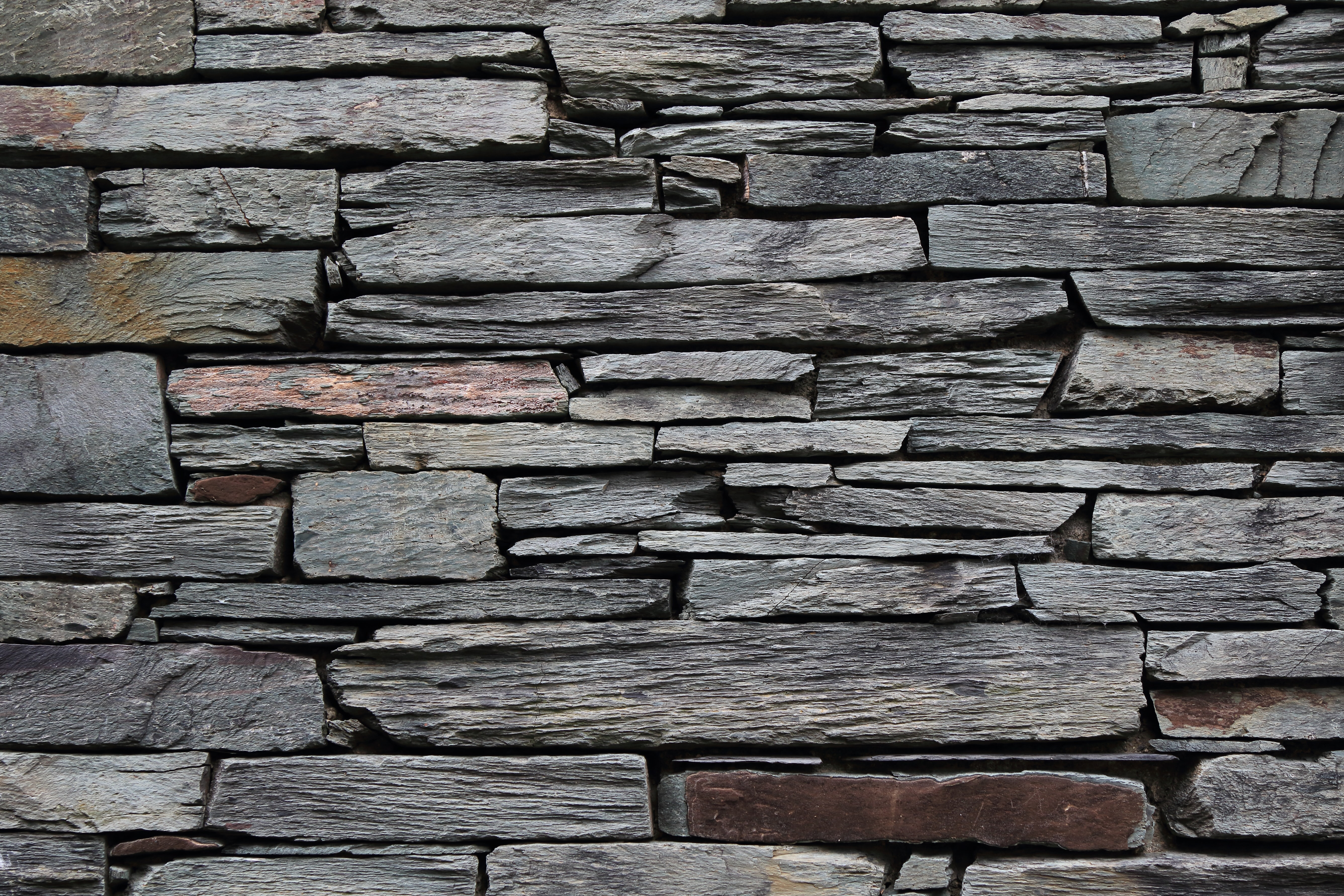 minimalist photography of gray rock wall