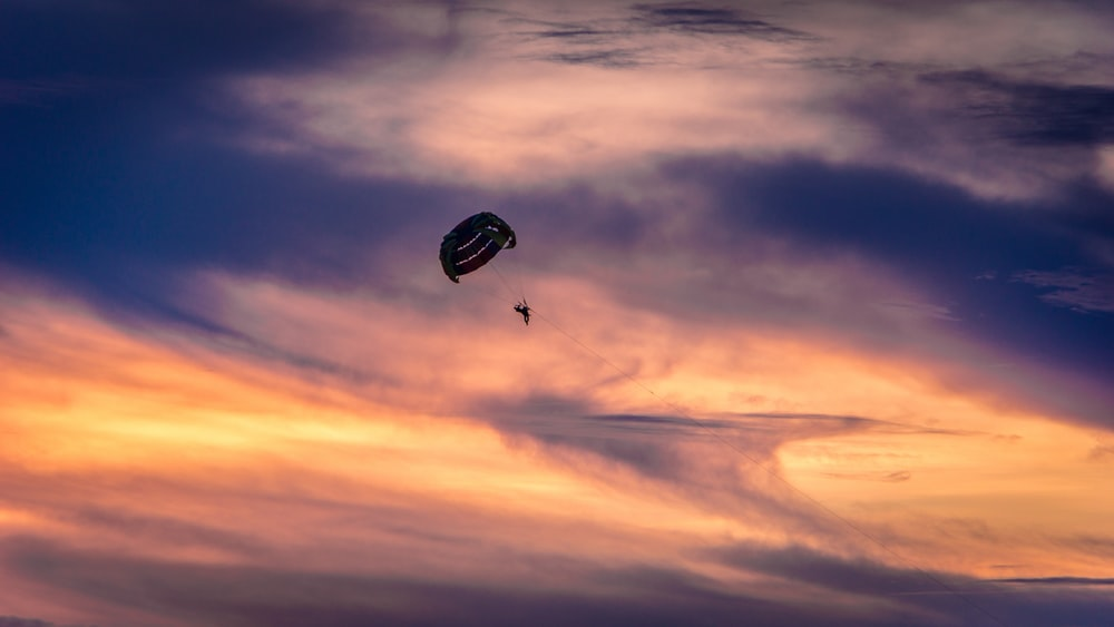 person paragliding in air during day time