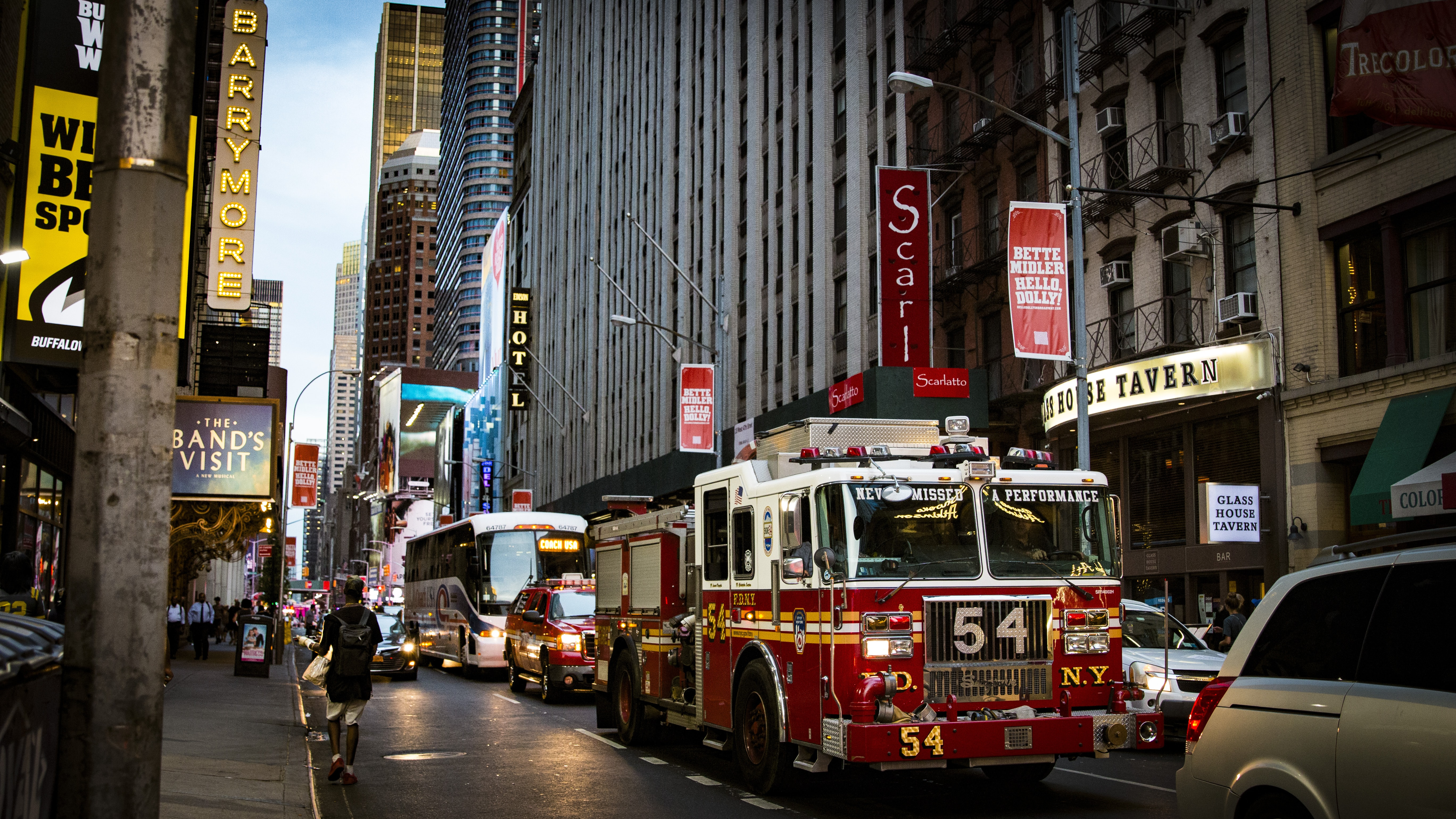Firetruck stuck in downtown traffic on a busy New York City street