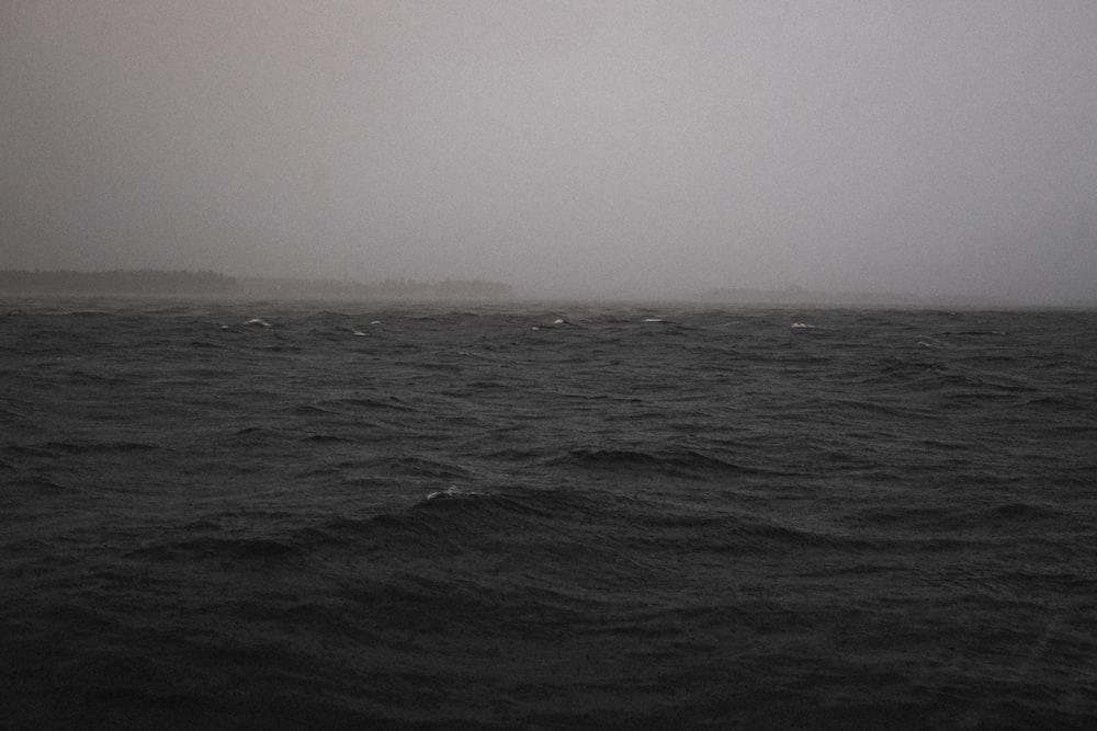body of water with heavy rain