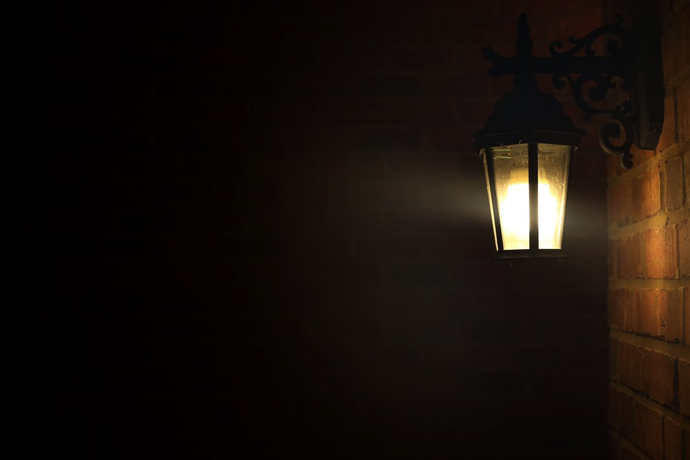 black and yellow wall sconce