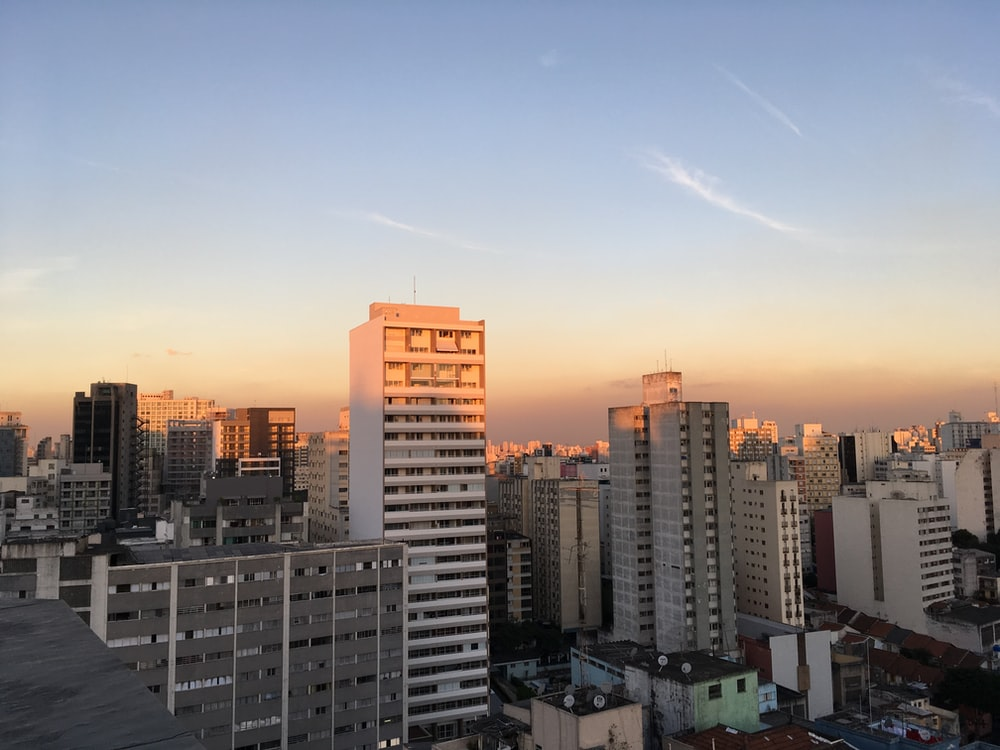 aerial photography of city buildings during sunrise