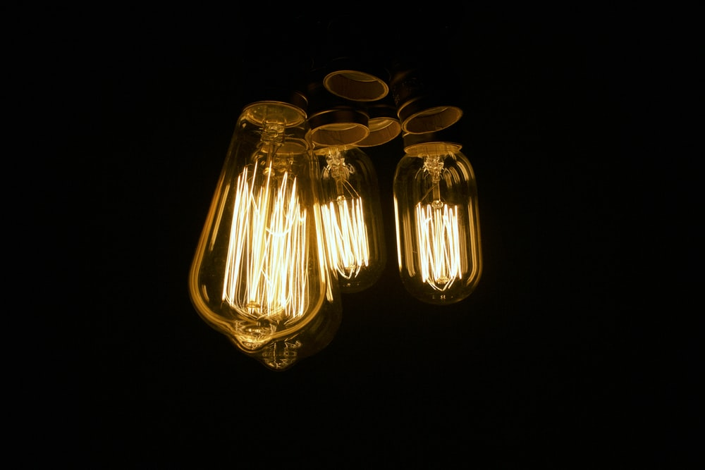 three clear light bulb