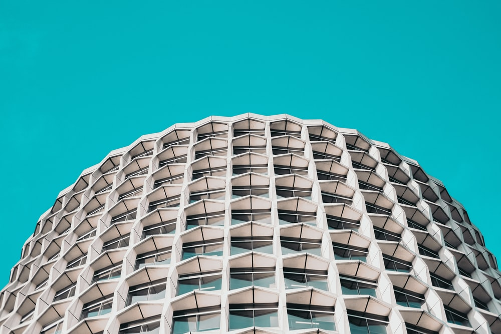 low-angle photography of white concrete high-rise building