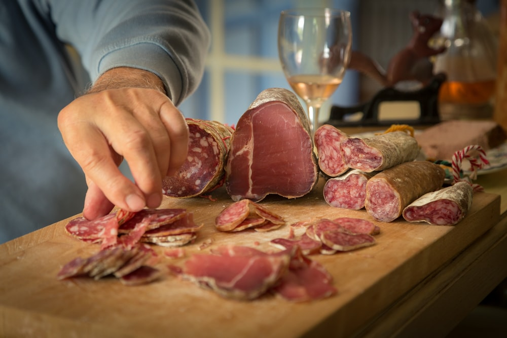 person slicing meat