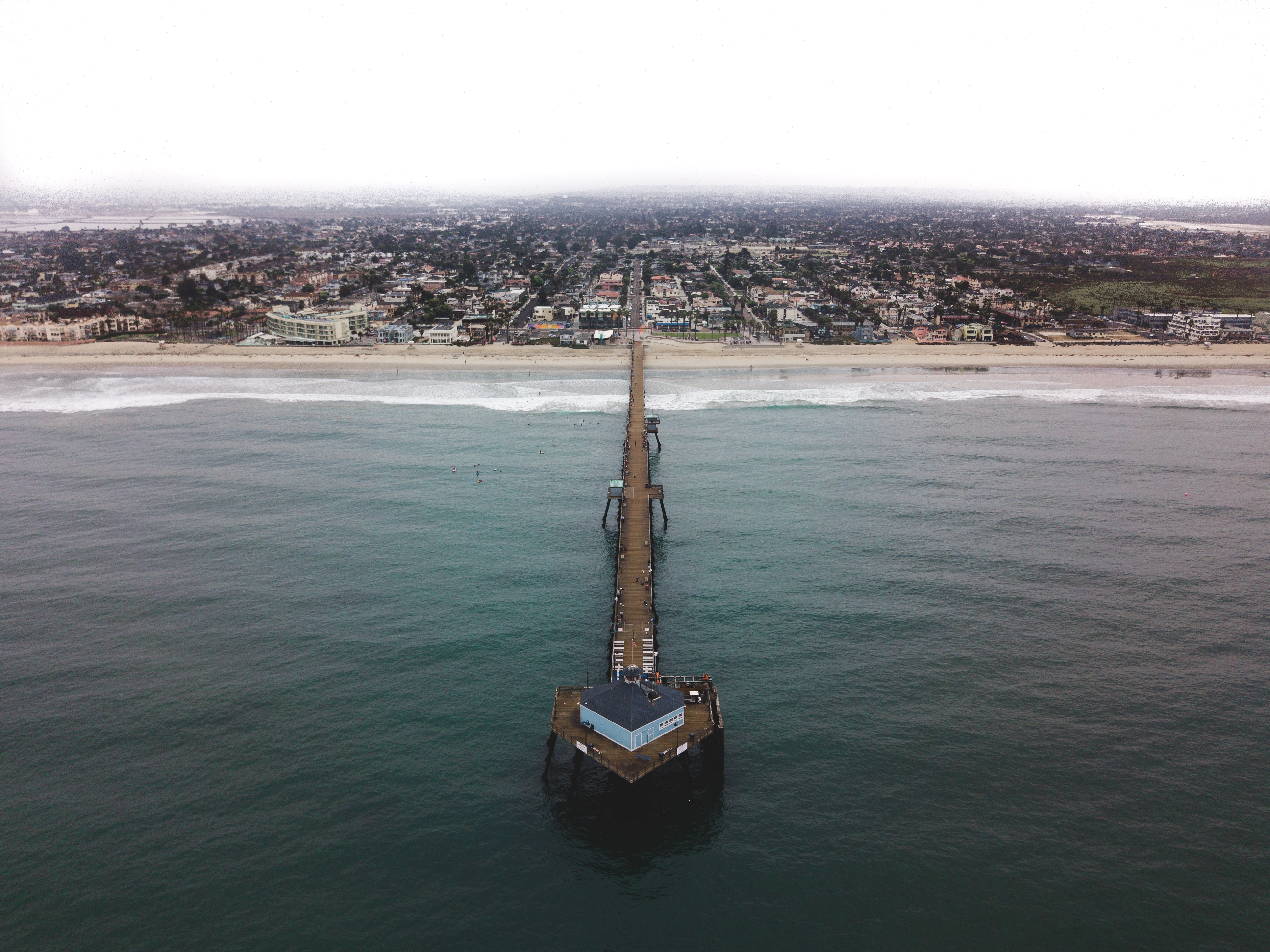 Drone view of a long pier at the Imperial Beach coastline