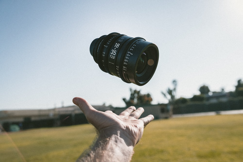 person catching camera lens
