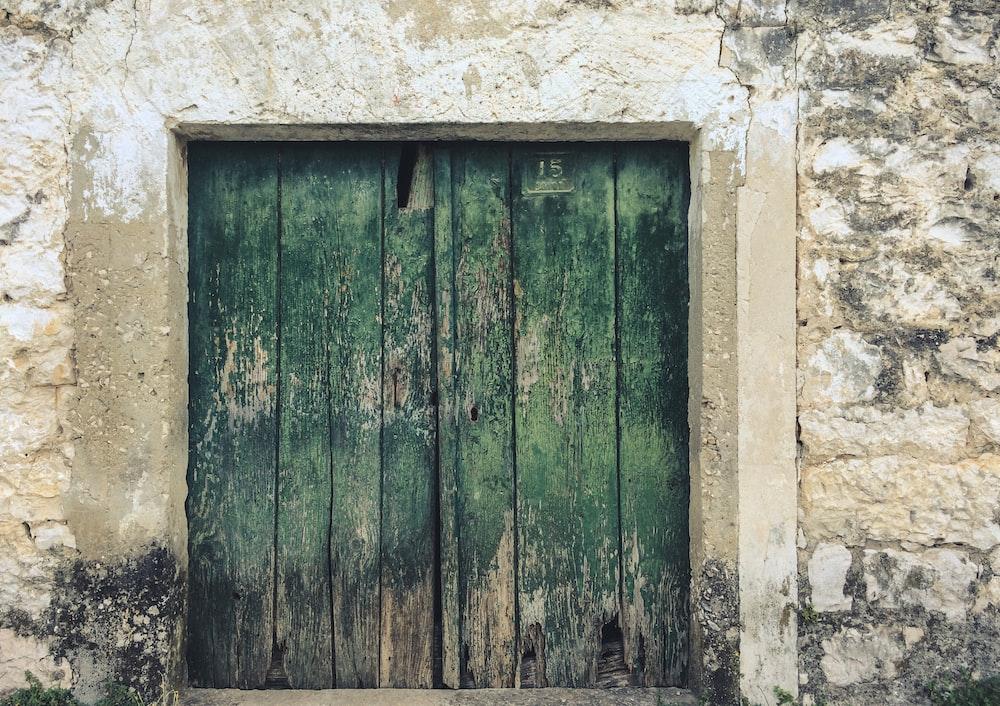 green wooden room door close