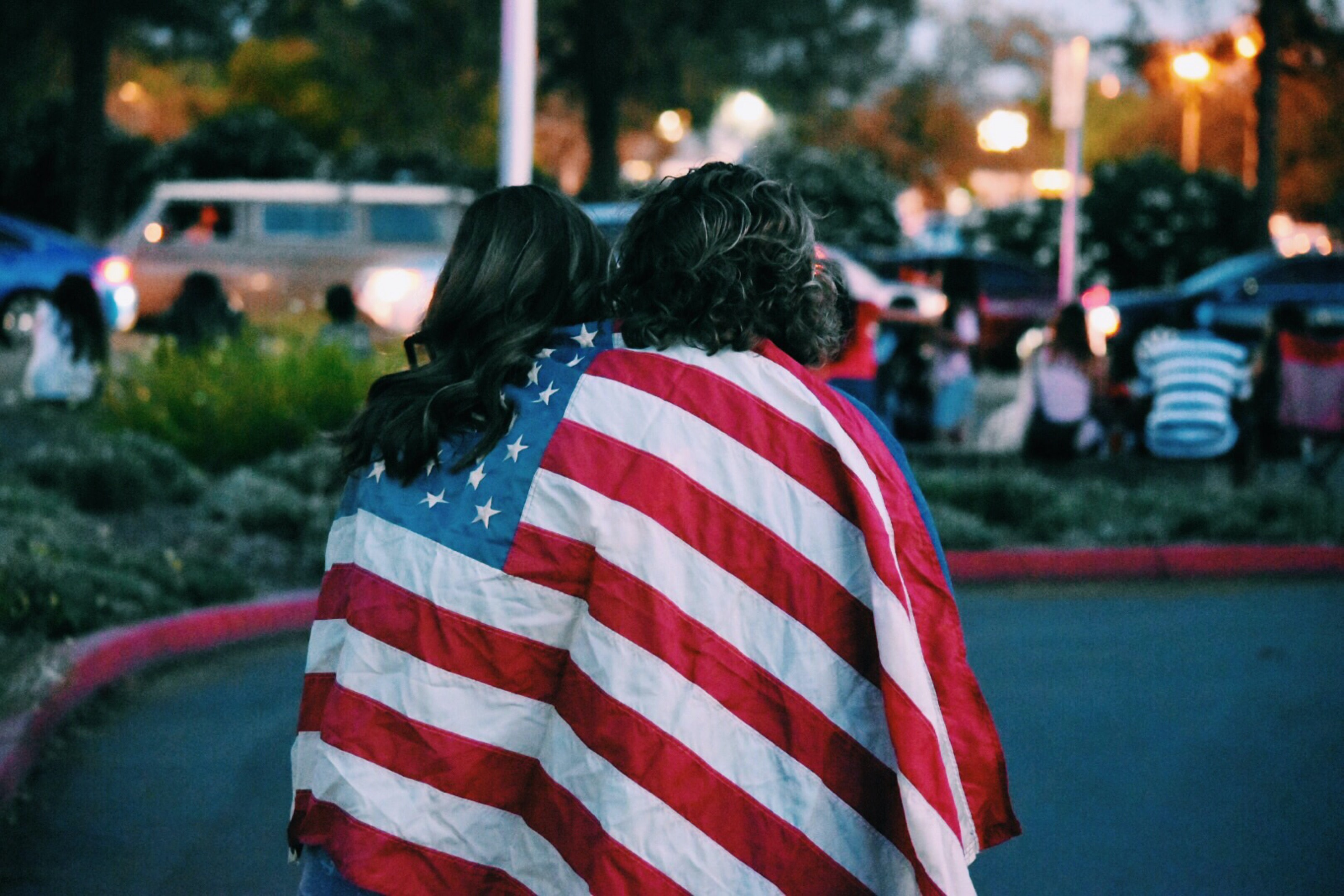 woman and man covered USA flag