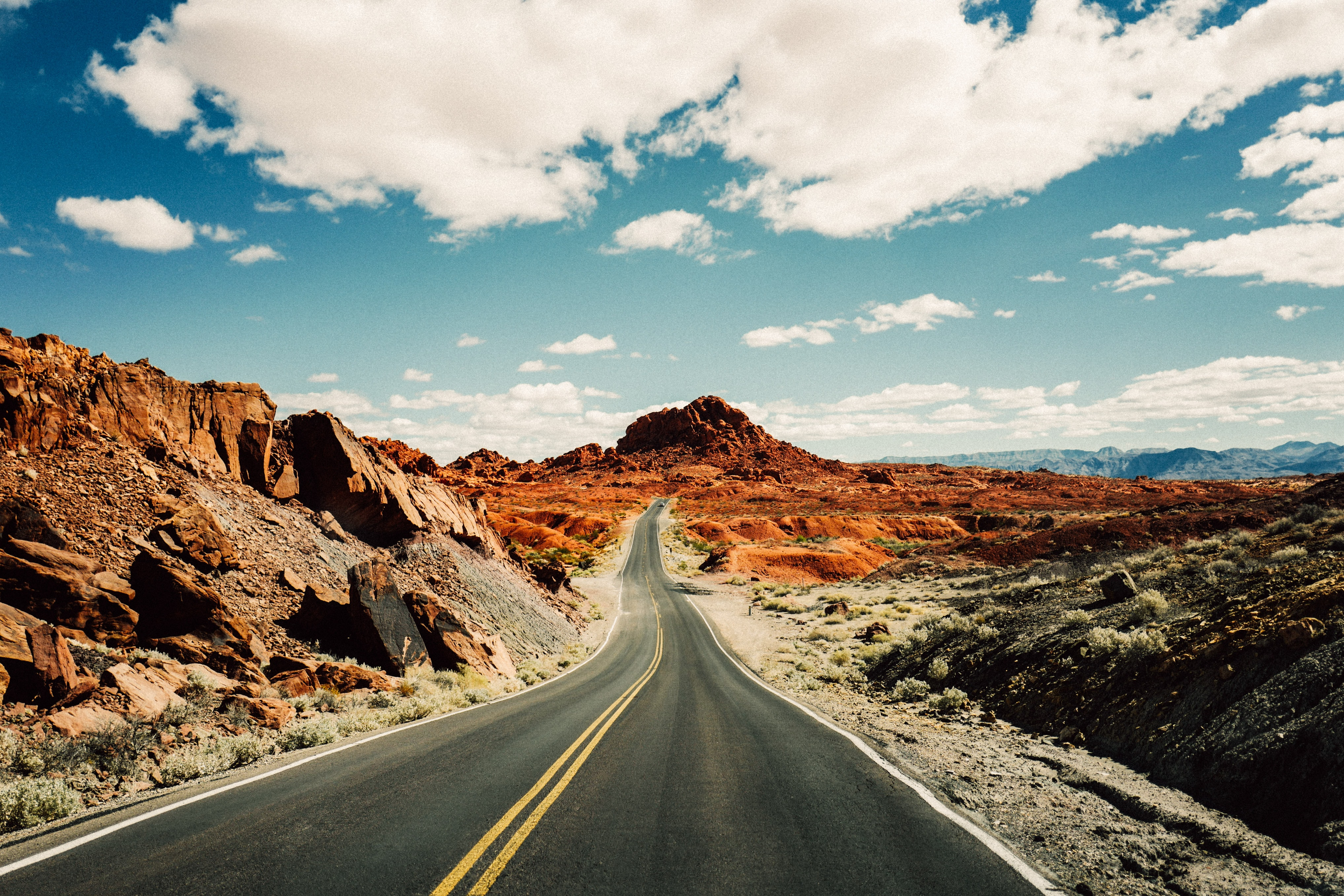 Open road in red rocky desert terrain of Valley of Fire State Park