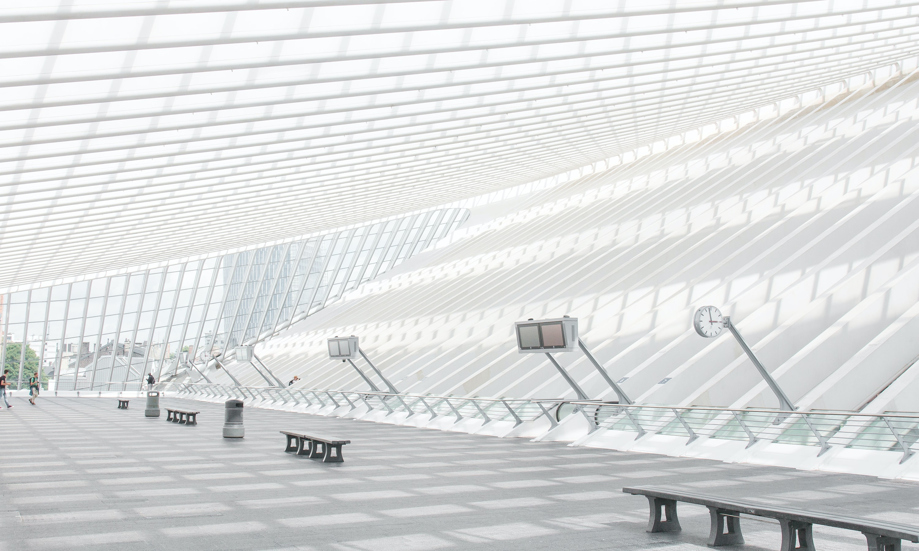 The modern white interior of the Liège-Guillemins railway station