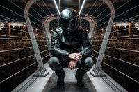 man in black full-face motorcycle helmet and jacket