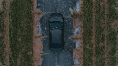 black vehicle running on road mitsubishi zoom background