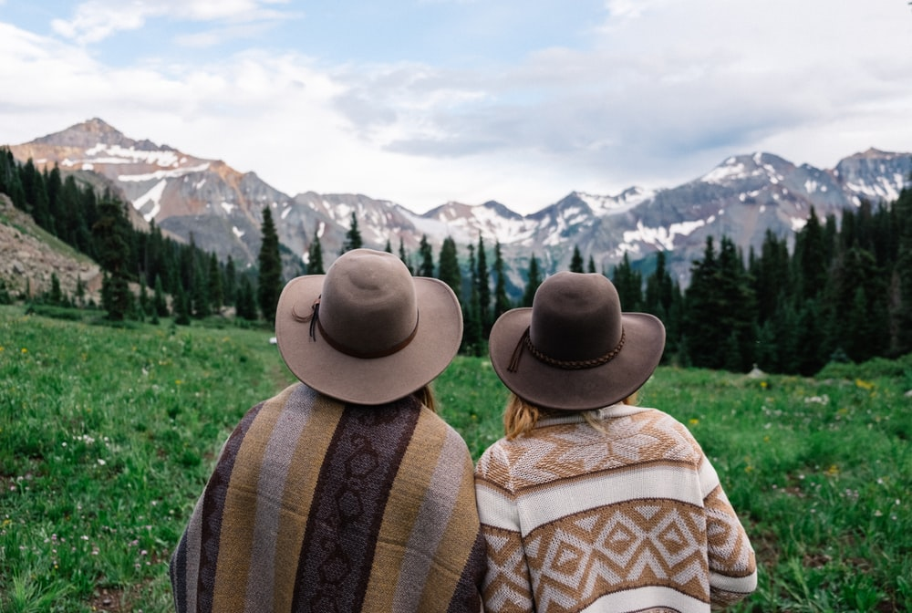 two people looking at the mountains