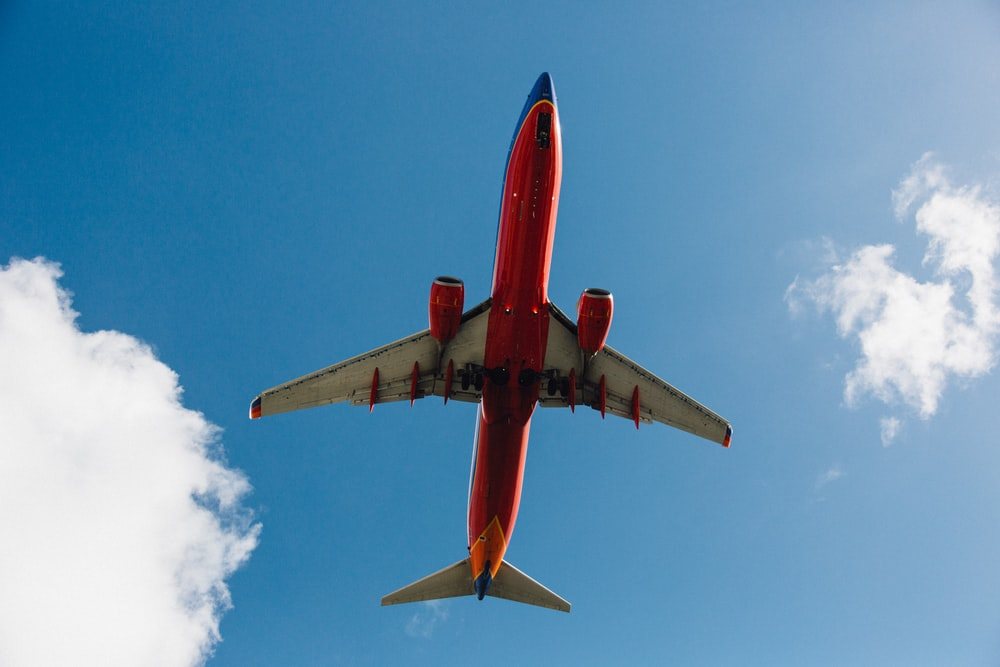 low-angle photography red and white plane