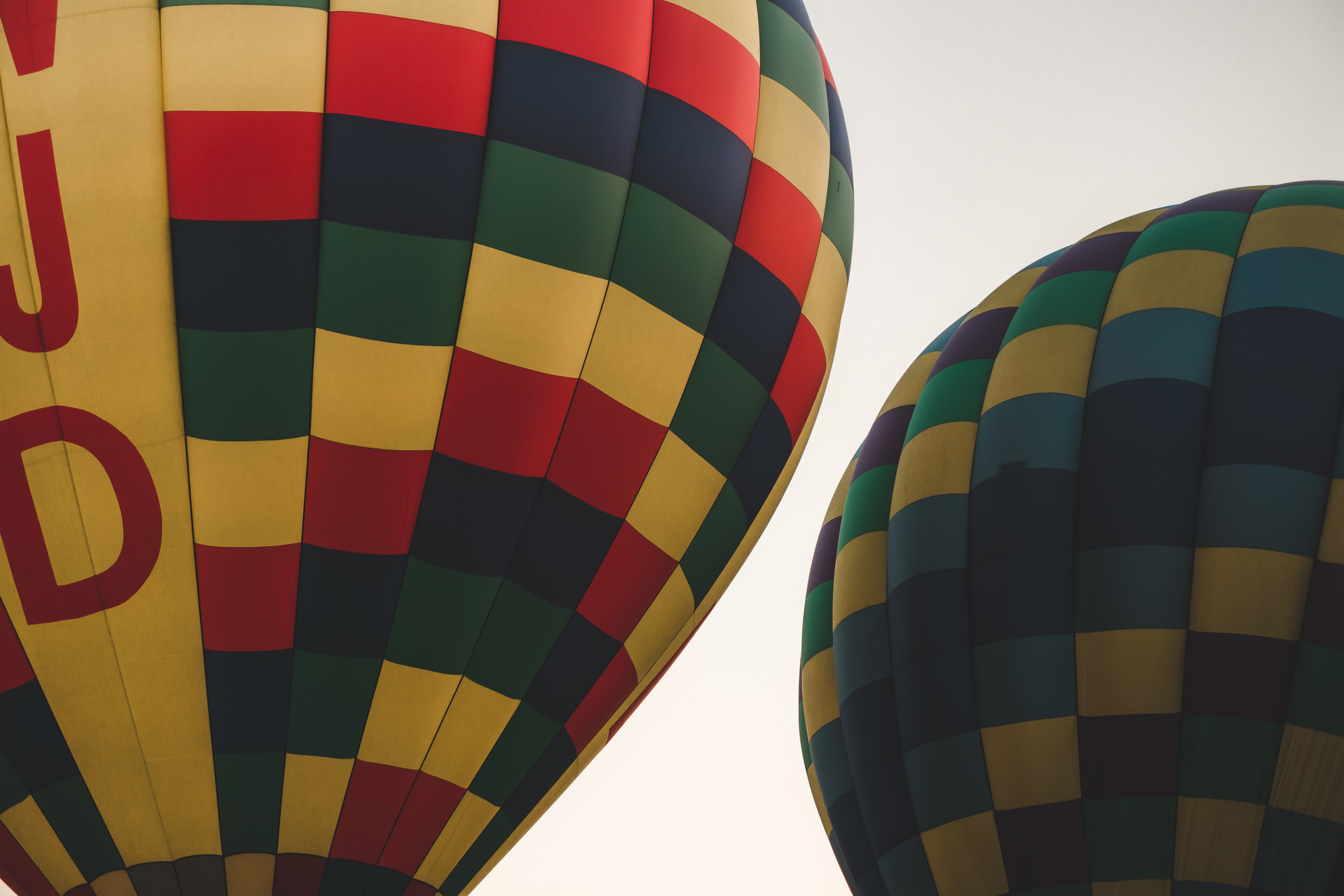 two multicolored hot air balloons