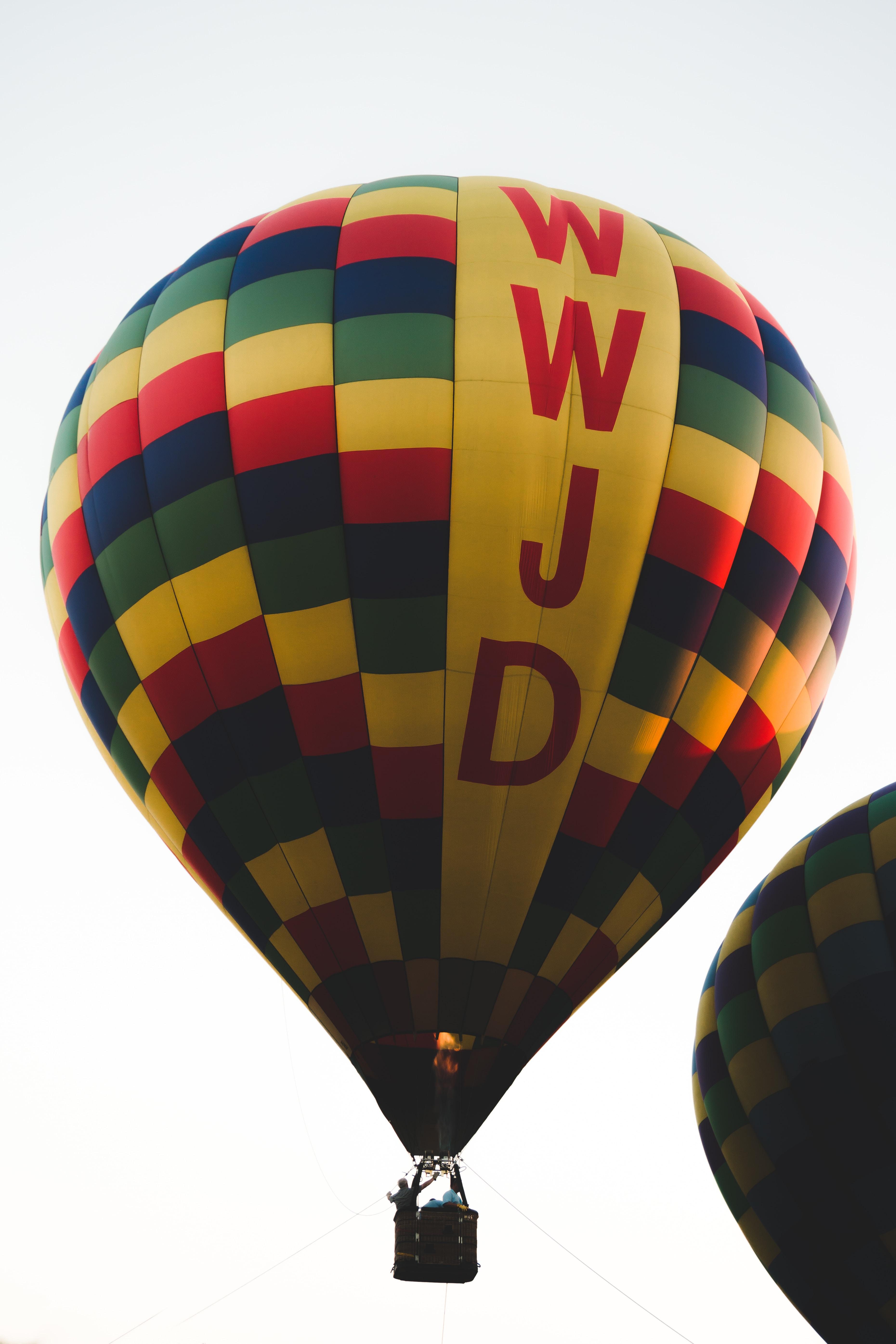 man riding on hot air balloon