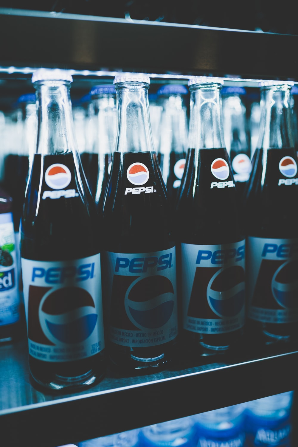 Pepsi bottles on cooler