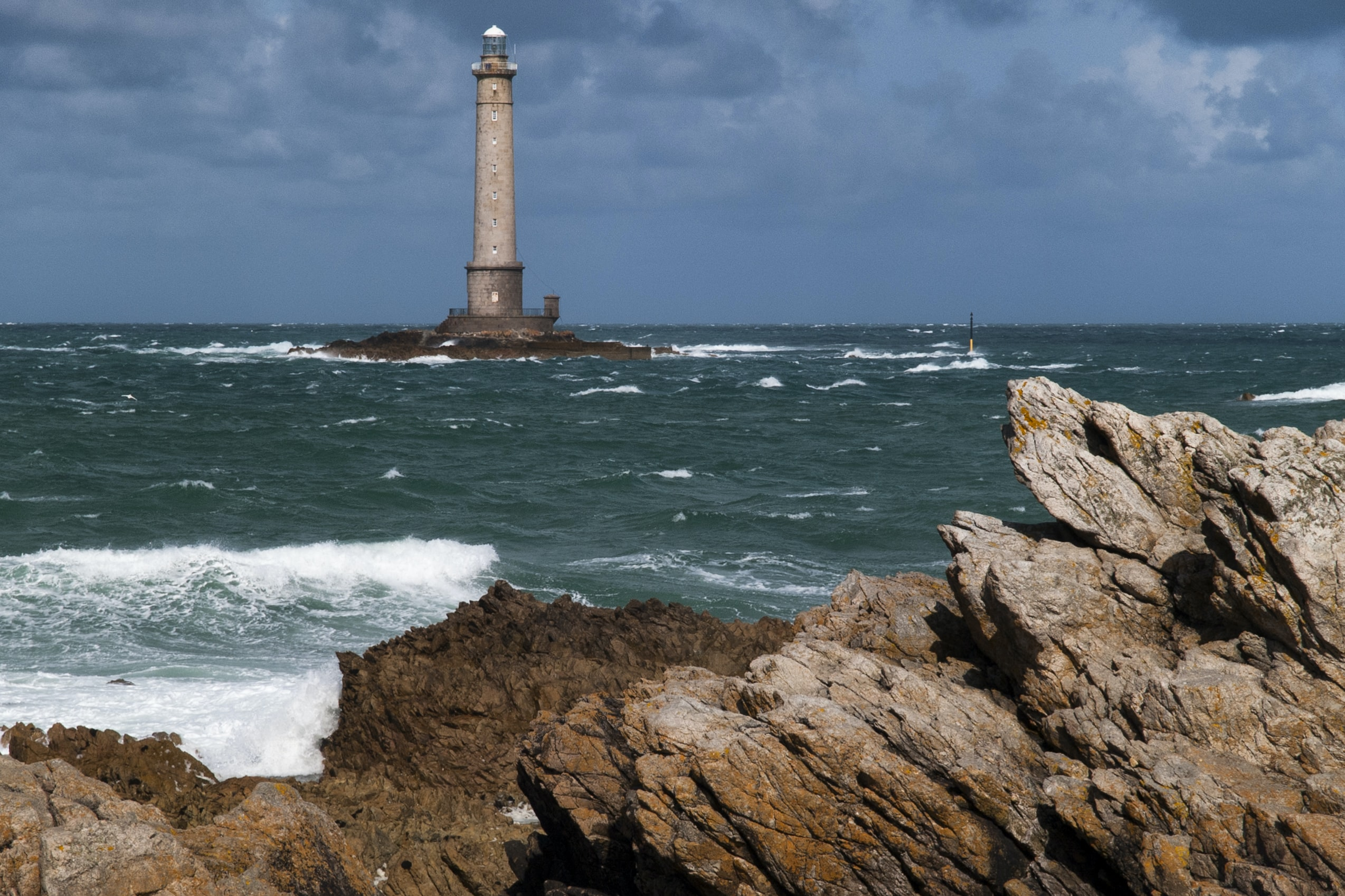 landscape photography of lighthouse near body of water
