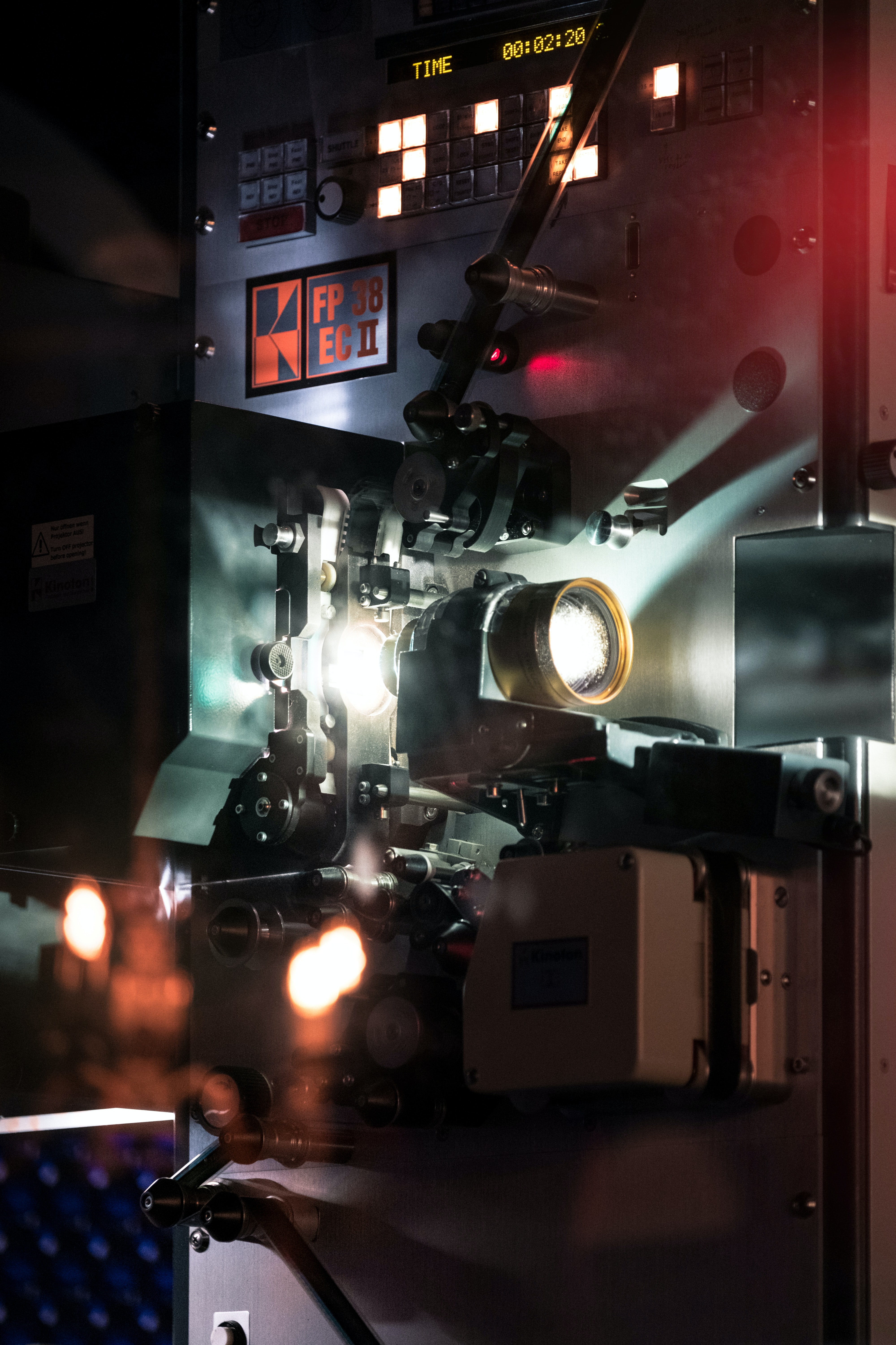 A movie projection camera  emitting light with a timer above