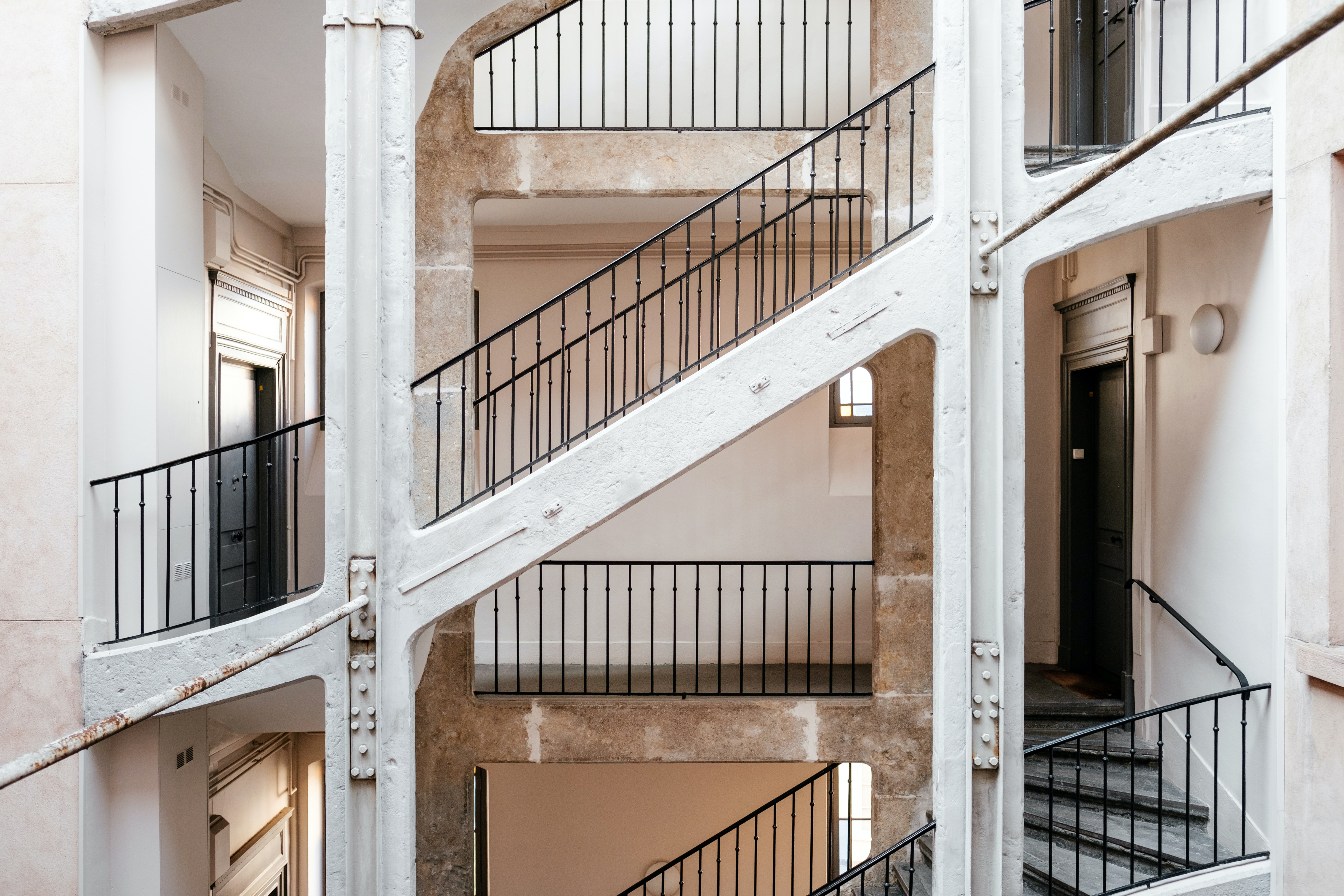 white concrete staircase with black steel handrails