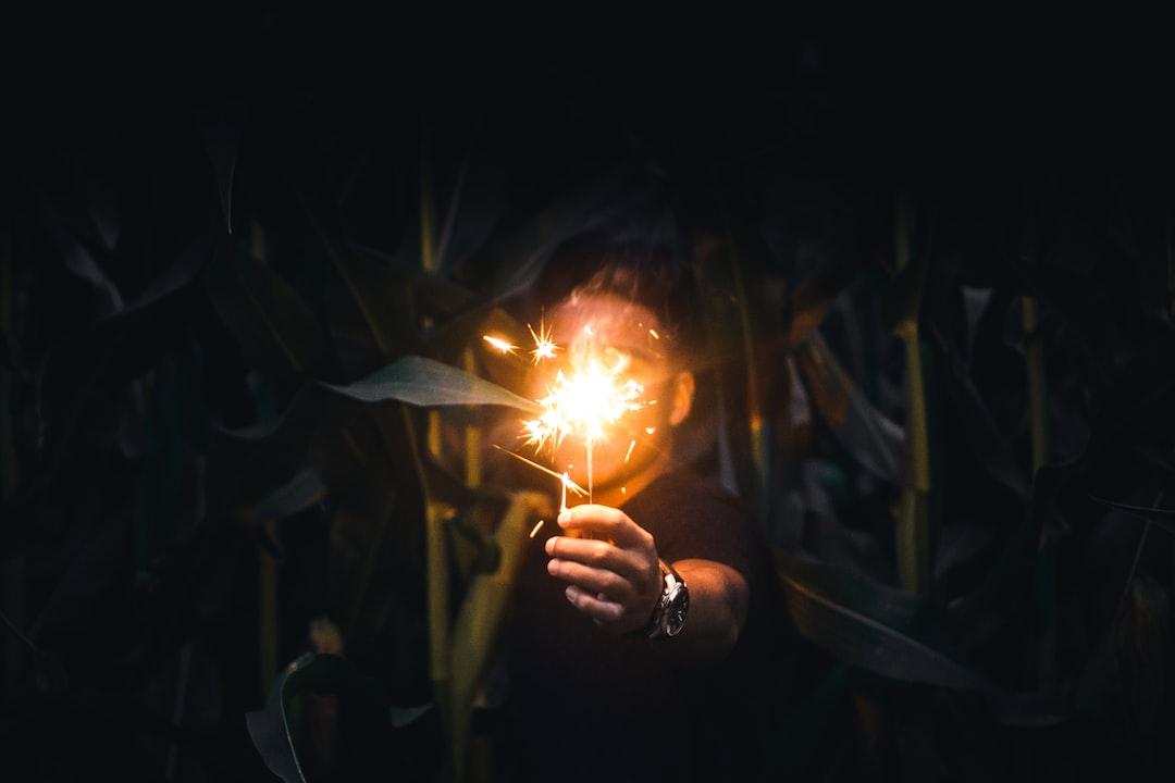 Holding sparkler in the dark