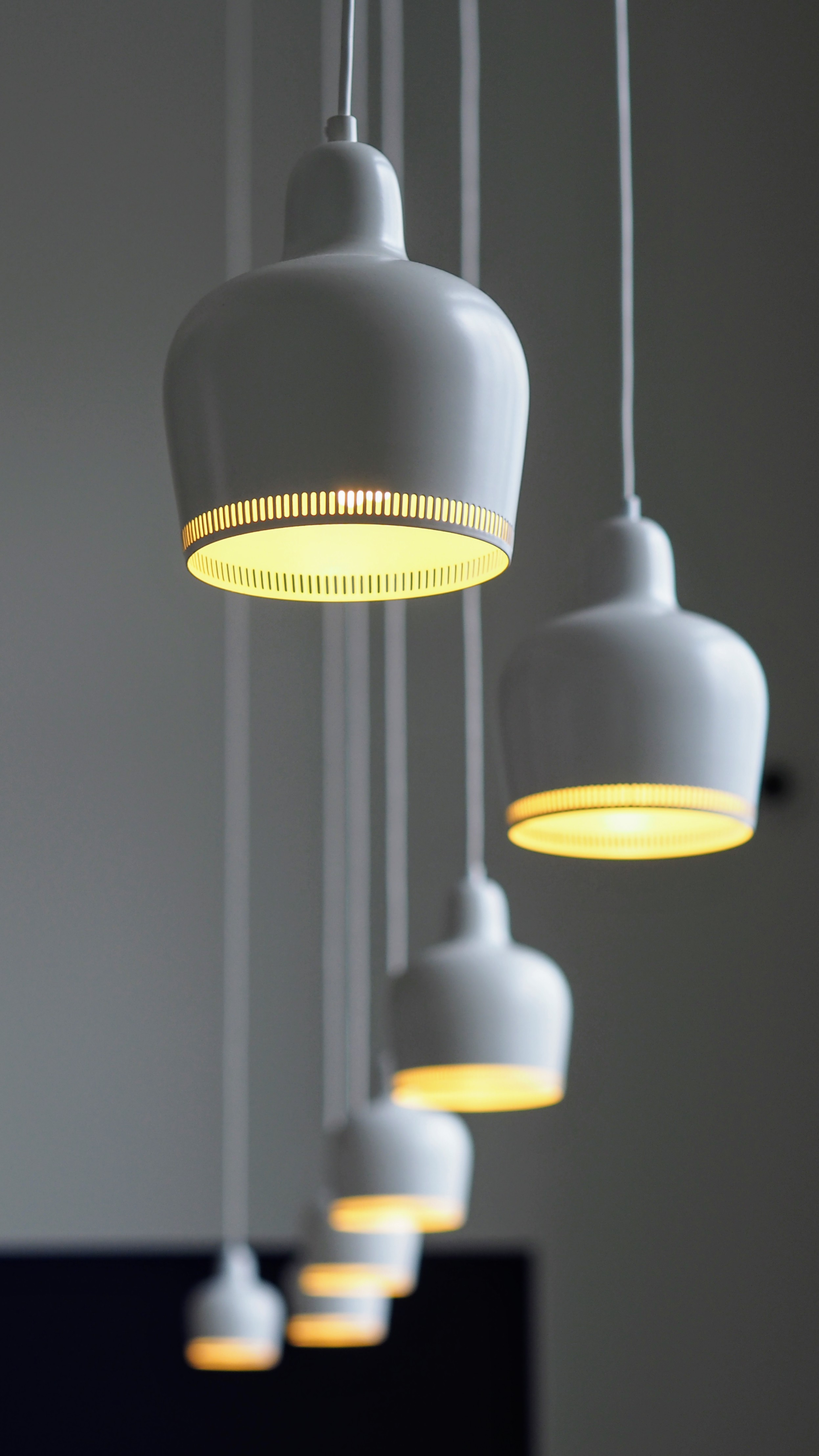 lighting for pictures. White Porcelain Lamps Hanging From A Ceiling On Long Wires Lighting For Pictures N